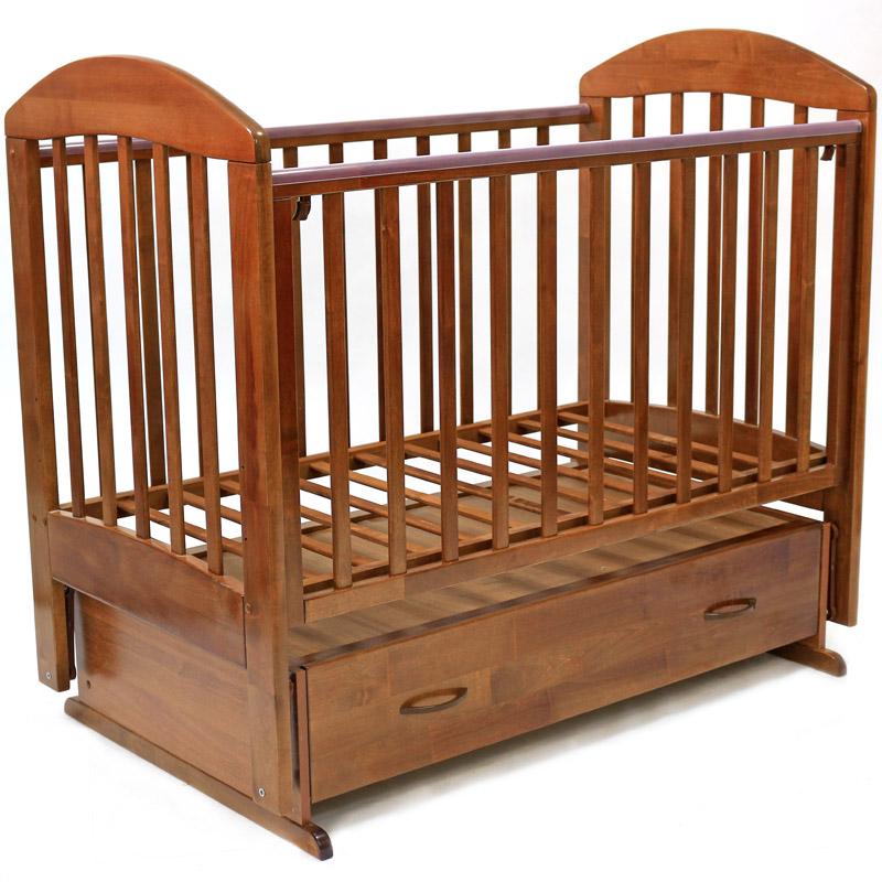 детская кроватка с маятником и ящиком фото